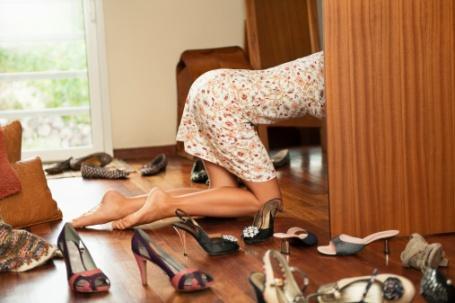 Woman inside locker looking for shoes